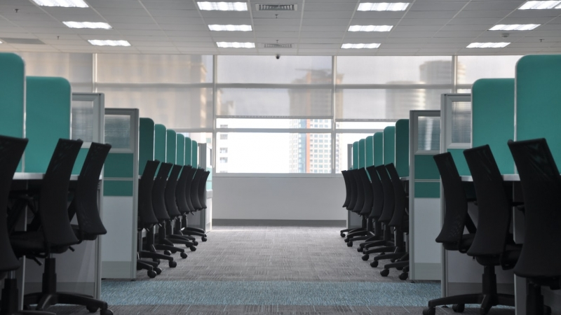 aisle of chairs and cubicles