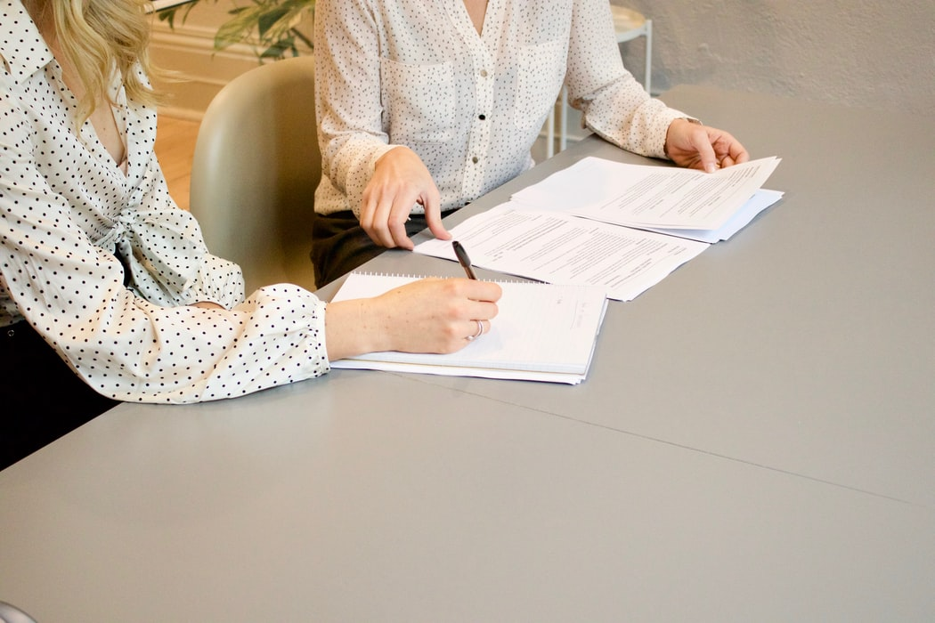 woman-signing-document