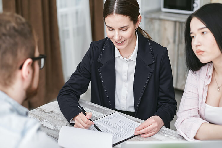 woman reviewing documents with couple