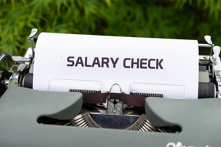 """typewriter with paper that says """"Salary Check"""""""